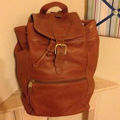 "Authentic Coach Large Backpack - British Tan I am downsizing & paying off debt. I DO NOT TRADE!  Vintage (from early-mid 90's) all leather brown backpack style bag from Coach. Measurements: 15"" H x 15"" W standing, 10.5"" x 9"" at base...it's big!!   Features: All leather exterior, black fabric interior, brass hardware, belt-buckle style closure & drawstring to cinch, interior zippered pocket, exterior zippered pocket, adjustable leather straps. Great bag!  **Price posted is lowest on Posh…"