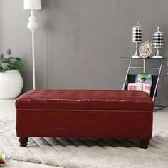 This classic bench ottoman offers sleek storage to tuck your items away with a button tufted, pillowy top to rest your feet. It features a solid wood frame for a touch of old world style and will be a lively addition in any room with its rich red color.