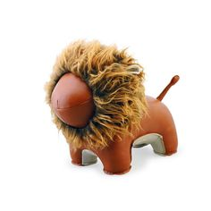 Who says bookends have to be boring? This darling leather lion bookend is the perfect addition to your child's shelf! #PNshop #nursery #kidsroom