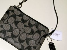'BNWT COACH Peyton Signature Small Wristlet ' is going up for auction at  2pm Fri, Dec 6 with a starting bid of $10.