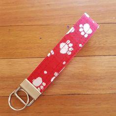 Check out this item in my Etsy shop https://www.etsy.com/au/listing/554310516/paw-print-wristlet-key-fob-wristlet