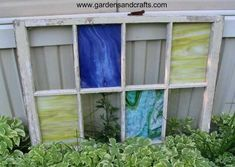 Upcycled old window with replaced stained glass panels