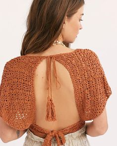 Slide View Frill Edge Crochet Crop Top Boho crochet top featured in a cropped silhouette with a plunging V-neckline. * Front button closures * Wide short sleeves * Open back * Adjustable tie at the back waist and neck Mode Crochet, Diy Crochet, Boho Hippie, Crochet Crop Top, Crochet Bikini, Festival Outfits, Festival Clothing, Knit Fashion, Crochet Clothes