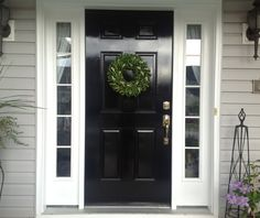 Love black door with white trim.  Perfect for our door for sure.