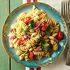Prosciutto and Beans - Easy pasta recipes don't have to start with jarred sauce. Beans, fresh tomatoes, prosciutto, and greens (plus cheese and garlic butter) make up the savory pasta partner. Best Italian Pasta Recipes, Italian Pasta Dishes, Easy Pasta Recipes, Bean Recipes, Seafood Recipes, Healthy Recipes, Italian Meals, Pasta Dinners, Seafood Dishes
