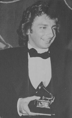 Barry Manilow Barry gram cover. Barry Manilow with his Grammy for Copacabana.