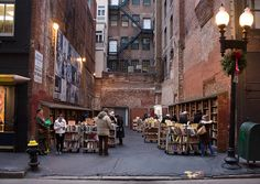 Take a trip to the Brattle Book Shop. The Brattle Book Shop is one of the oldest and largest used book shops. Not only do they have 3 stories worth of books, they have an outdoor sale lot, shown in the photo. Atlantis, Boston Things To Do, Alleyway, In Boston, Boston Town, Boston Weekend, Downtown Boston, Bookshelves, New England