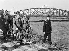 Hitler walking beside the River Vistula in Poland during his visit to the front.