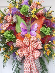 Spring and Summer Colorful Butterfly Mesh Wreath  by WilliamsFloral on Etsy https://www.etsy.com/listing/229049401/spring-and-summer-colorful-butterfly