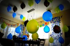 Easiest party decor ever.  Fill half of your balloons with helium, the other half blown up with air...tie one non-helium balloon to a helium balloon at alternating lengths.  Instant party--super fun for kids and adults alike.