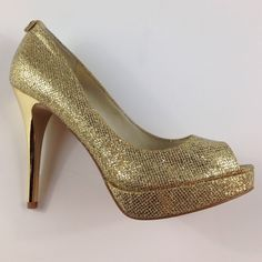 Michael Kors GOLD York Glitter Stilettos - 7.5 Has original tags, Peep toe design, slip on, gold glitter detailing, gold tone stiletto heel, heel height 4.25in, ORIGINAL RETAIL = $130.00 - no shoe box, which is why you are receiving a DISCOUNT. Michael Kors Shoes Heels