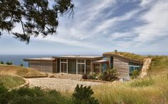 Dani Ridge House is a gorgeous contemporary vacation retreat carved into a hillside, designed by Carver + Schicketanz, located in Big Sur, California.