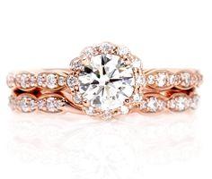 14K Rose Gold Moissanite Engagement Ring Wedding Set Wedding Band Diamond Halo Conflict Free. $1,770.00, via Etsy.