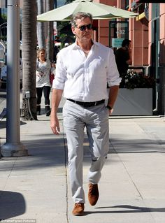 Dapper dude: Pierce Brosnan, 63, looked as though he hadn't aged a day since his 007 heyday as he enjoyed a low-key stroll in Beverly Hills on Thursday