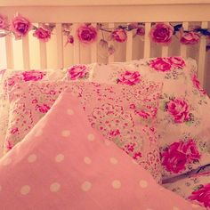 ❤ the flowers on the headboard, teamed with the hand made coverings on the pillows :)