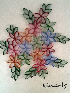 DIY : Toilet paper roll wall art.....cut paper rolls into five parts....paste them to make flowers and leaves and paint it to make a beautiful wall art....