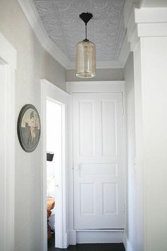 Never think of tin ceilings in a hallway, bit it really highlights them without the pattern overwhelming!