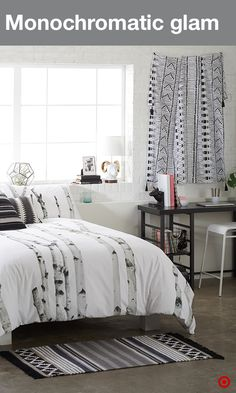 Create a cool monochromatic bedroom in your apartment with dramatic black and white décor. Inspired by nature, the birch-print duvet set has some serious thread-count power: 600-thread-count of pure silky luxury. Add a few decorative pillows and wall tapestry to complete the look. And don't worry… mixing and matching prints is a style must, not to mention warm pops of gold for a little glam.