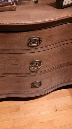 Love those drawer pulls with key holes. From Restoration hardware