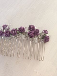 Purple flower and crystal bead hair comb  on Etsy, £9.00 (Would look lovely around/on top of your veil)     Love you, Mom
