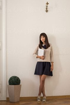Young Businesswoman in the Office by Mosuno for Stocksy United
