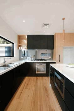 Alphington Townhouses by Green Sheep Collective 11 Wood Floor Kitchen, Black Kitchen Cabinets, Kitchen Cabinet Design, Black Kitchens, Kitchen Flooring, Home Kitchens, Kitchen Decor, Kitchen Black, Timber Kitchen