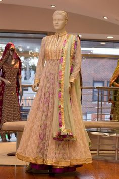 Mint Green/Purple and Crema lacha Embroidery: Tread, Aari, and Zri with Sequence borders Fabric: Top Anarkali - Lace/Net Lehenga - Chanderi Silk Dupatta: Net For More information please contact sales@sahil.com