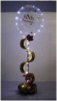 PlexiPoles and air filled balloons create this endless design by Jane Naggar Balloon Table Centerpieces, Balloon Arrangements, Balloon Columns, Balloon Arch, Balloon Ideas, Bubble Balloons, Giant Balloons, Transparent Balloons, Balloon Display