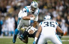 Quarterback Cam Newton #1 of the Carolina Panthers is sacked by Malcolm Jenkins #27 of the New Orleans Saints at Mercedes-Benz Superdome on December 8, 2013 in New Orleans, Louisiana.