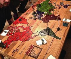 Wake up and conquer the world as you enjoy a hearty breakfast on the Risk board game coffee table. Decorated with an actual Risk board game carved on the surface, it doubles as both a charming coffee table and a sturdy game board.