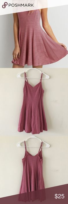 AEO • Coral Striped Sleeveless Dress AEO • Super soft dress from American Eagle. Coral & navy striped. Sleeveless. Adjustable strap. Flare fit in waist (skater dress style). Great condition!   🌸 No trades. 15% off when you buy at least 2 items from my closet. 🌸 American Eagle Outfitters Dresses Mini