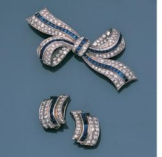 A sapphire and diamond brooch and pair of earclips,