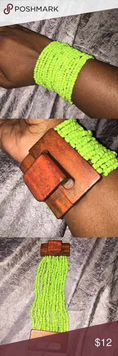 Very pretty lime green and wood beaded bracelet. Very pretty lime green bracelet. This does have stretch so it can fit a larger or smaller wrist. The perfect accessory to jazz up a plain outfit. Jewelry Bracelets