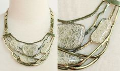 Nesting Necklace- Antique gold necklace featuring flat pendant segments and translucent stones.    Color: As shown  Price: $17.00