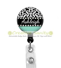 This Retractable ID Badge Holder is super darling. Personalized Black Damask, this is just super cute !  All names can fit, but the longer the name the smaller the font. PLEASE INCLUDE PERSONALIZATION INFORMATION IN THE SELLER BOX AT CHECKOUT. The bottom portion (green-ish blue) color can be changed to any color that you prefer. Just be sure to be specific about your color preference (example: light purple or bright blue, etc) Also include that in the seller box at checkout. If I have any…