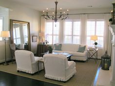 white curtains with plantation shutters