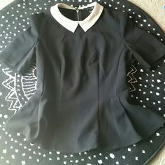 Forever21 peplum shirt Cute black Peplum with zippered back and tan color. In great condition Forever 21 Tops