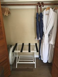 Cozy robes and umbrellas provided along with a fan, beach towels, extra blankets, a luggage rack, iron & ironing board are stowed in the closet.