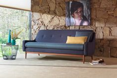 GPlan Vintage - G plan have relaunched their classic MidCentury styles. love this sofa - see www.gplanvintage.co.uk  for the full range.