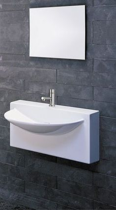 wall mounted sink saves LOTS of space aand hassle in a small bathroom