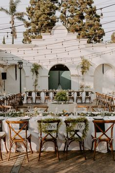 This outdoor reception is totally chic with greenery + a simple black and white color palette | Image by Katie Ruther Photography