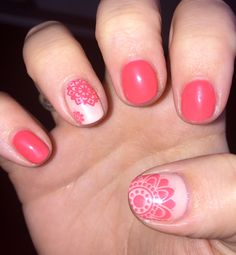 Pretty coral Gelish nails, with a geometric flower design.