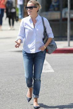 Reese Witherspoon demonstrates that the right pair of flats – (like these pointed and studded Miu Miu flats) can sharpen up the a simplest of outfits.
