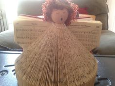 Church hymnal turned angel.