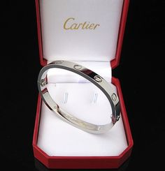 Cartier Love bracelet... would also love this in yellow gold