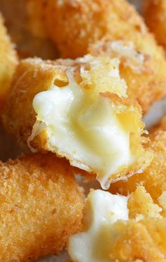 Fried Cheese Sticks•12 Mozzarella string cheese (or other cheese cut in 24 finger size sticks) •½ cup flour •⅓ cup corn starch •2 eggs •2 tablespoons olive oil •1,5-2 cups bread crumbs •oil for frying