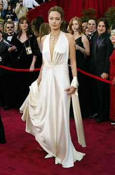 Channeling a Grecian goddess, Jolie wore this white satin�Marc Bouwer gown to the Academy Awards. via StyleList
