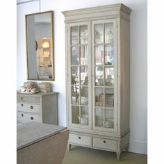 love the gray, or greige color of this armoire.  I want to paint my bedroom funiture this color.