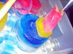 -colored water in spray bottles or emptied dish soap containers and encourage them to paint the snow  -freeze colored water in a variety of containers to be used to create colorful ice structures.