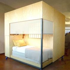 The Cube is an 8 square-foot mobile dwelling unit that solves the dilemma of lack of coziness in a work/live loft, using Feng Shui.